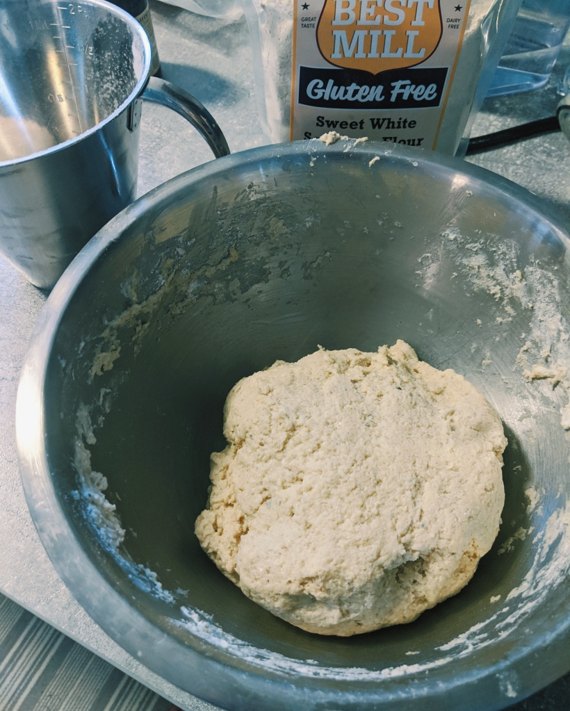 The dough should come away from the bowl edges easily.