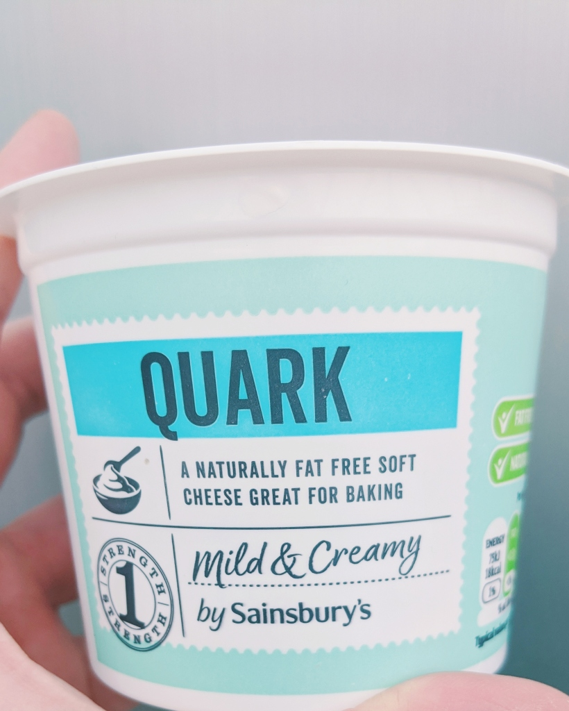 Quark is a soured milk product that is close to a soft cheese but more tangy in flavour. It can be found in the cheese isle in most supermarkets.